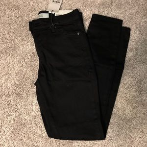 Black jeans with rips at both knee caps
